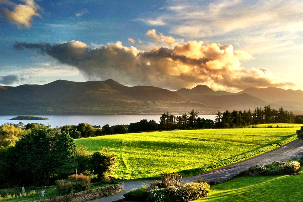 landscape view of green fields in Ring of Kerry, Killarney, Ireland
