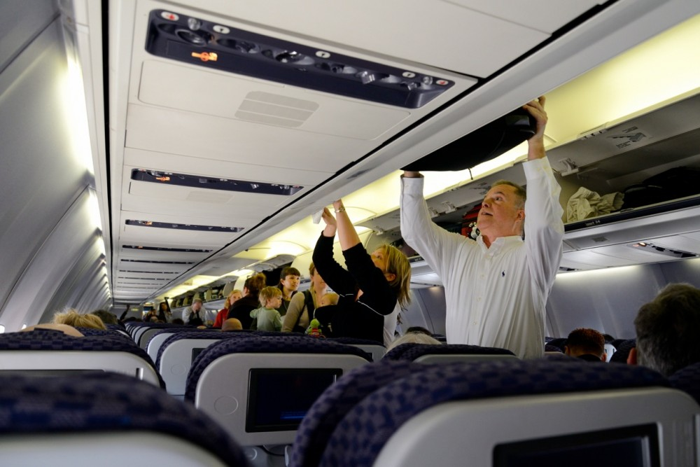 Overhead bins, carry-on luggage