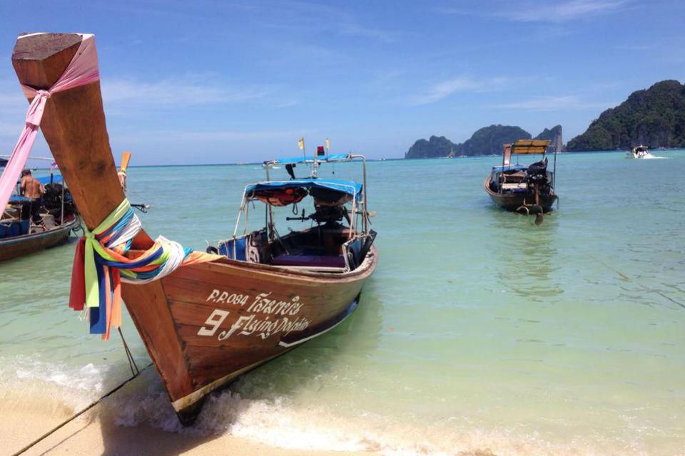 small boat on beach of Koh Phangan island Thailand
