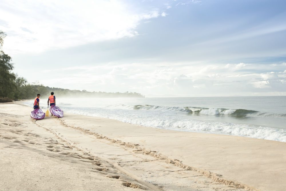 2 people walking on beach in Phu Quoc island Thailand
