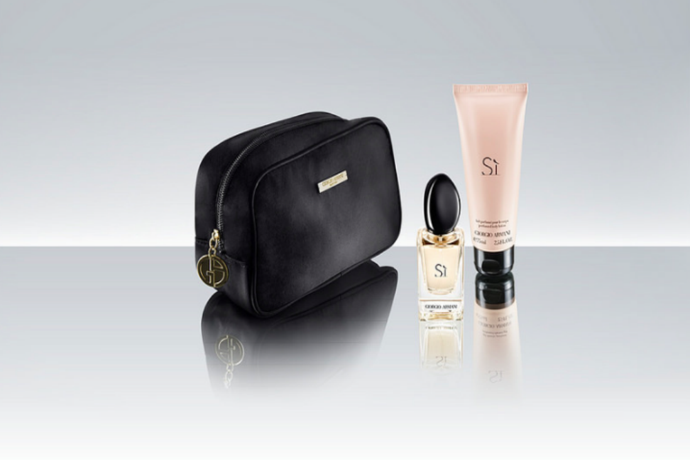 The Giorgio Armani business class amenities kit contains perfume and lotion—men get one set, women get another.
