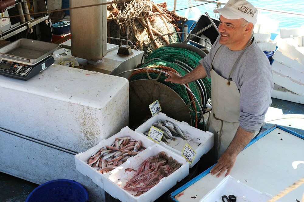 Some of the catch of this commercial fishing boat is reserved for selling to the locals.