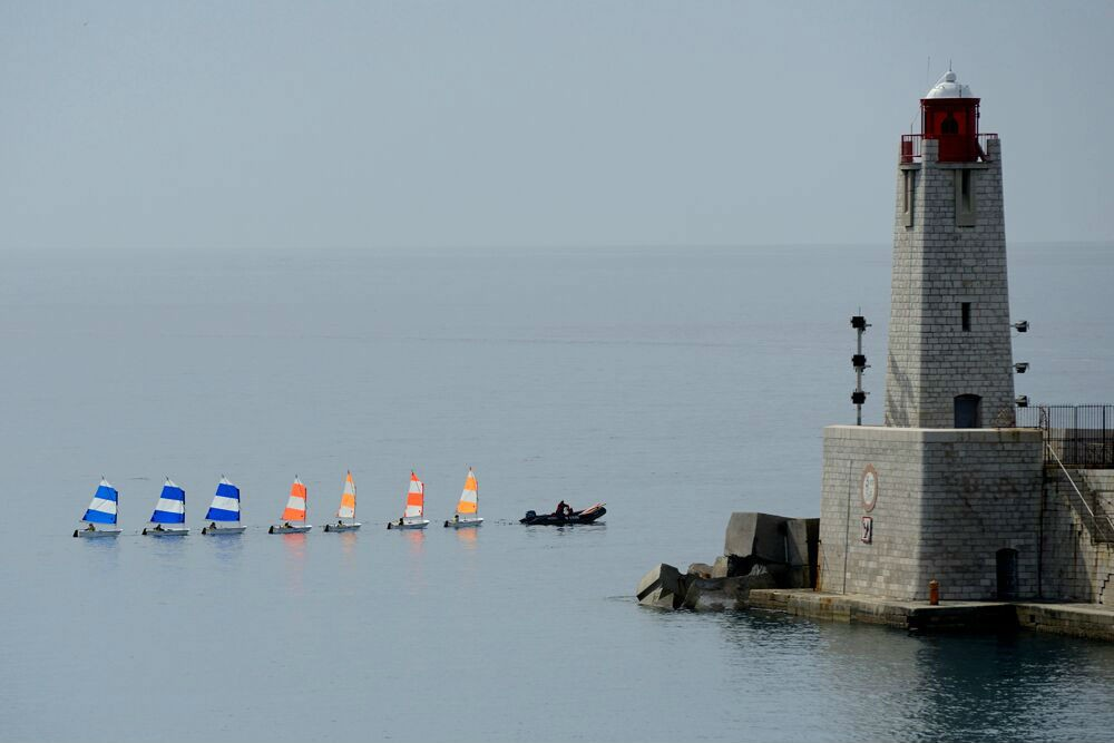 A sailing class at the entrance to Nice's harbor.