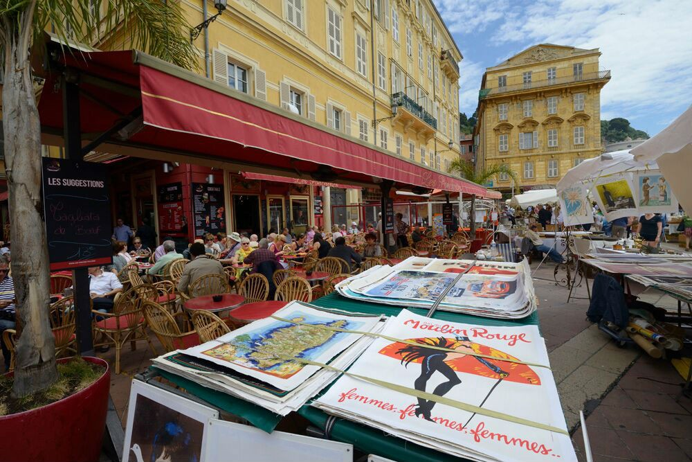 "Posters for sale at the Cours Saleya antiques market. The prices were high, and I've seen enough ""Roadshow"" to be leery of reproductions masquerading as the real thing."
