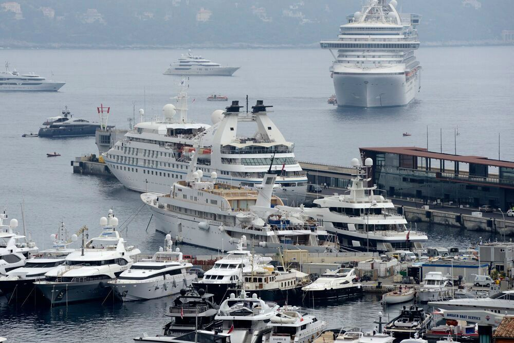 In Monte Carlo, Star Breeze docked at the marina, whereas a larger Royal Caribbean ship anchored.