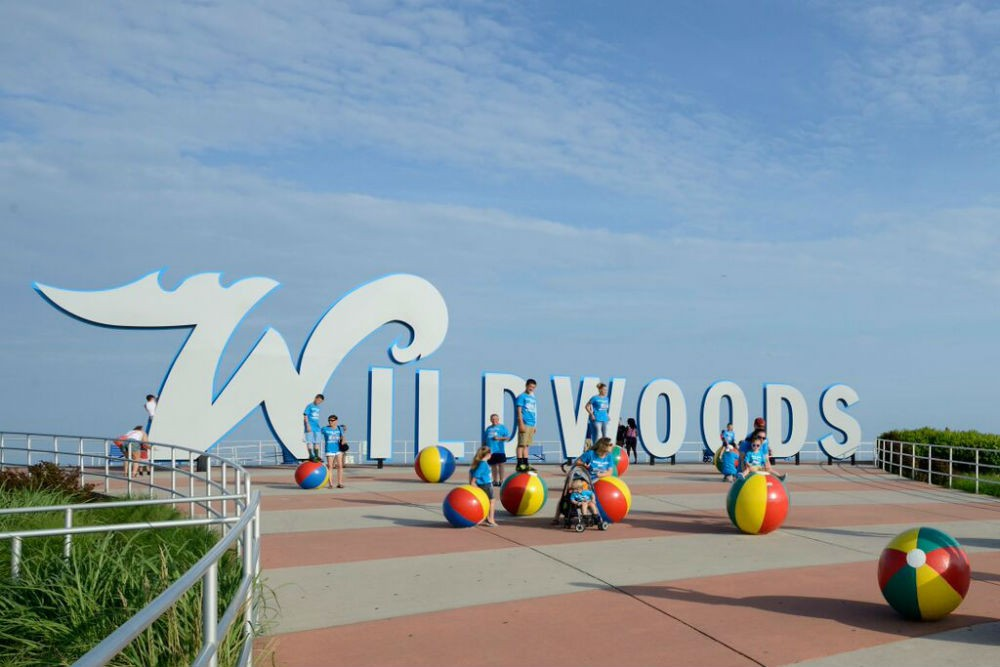 Many large family groups seeking a budget-friendly vacation choose Wildwood—including this group posing at one of the beachfront landmarks.