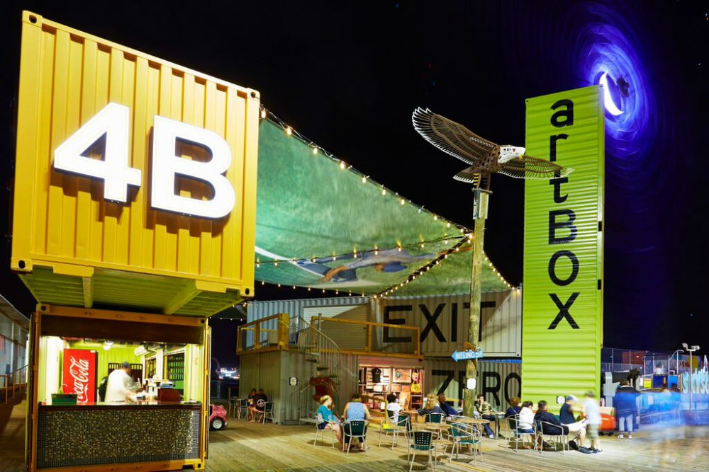"artBOX, an ""artists' village"" made from shipping containers, sits on one of the amusement piers and offers art classes."