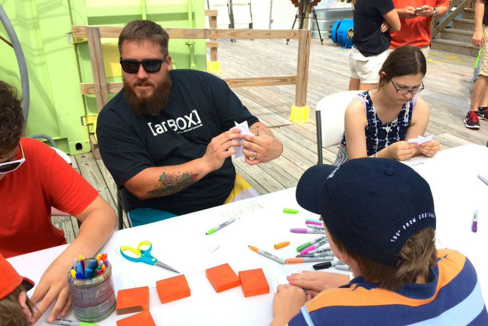 Local artist David Macomber teaches origami at artBOX.