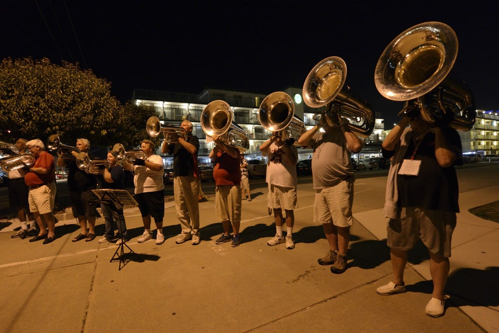Veterans of the Hawthorne Caballeros Drum and Bugle Corps having an informal jam session by the beach.