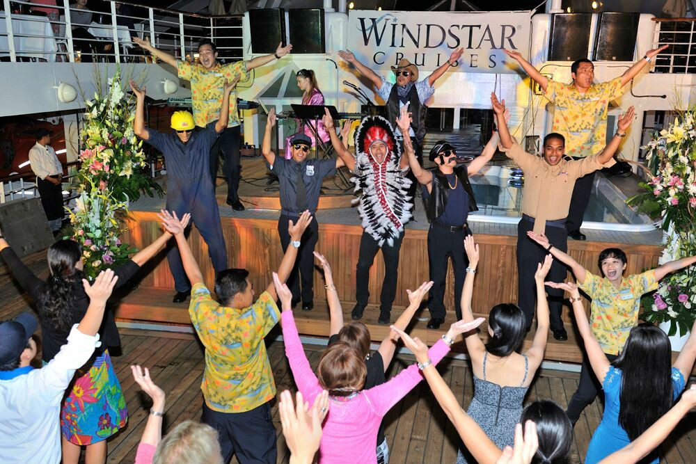 The Village People (a.k.a. the Star Breeze crew) performs YMCA at the deck barbeque.