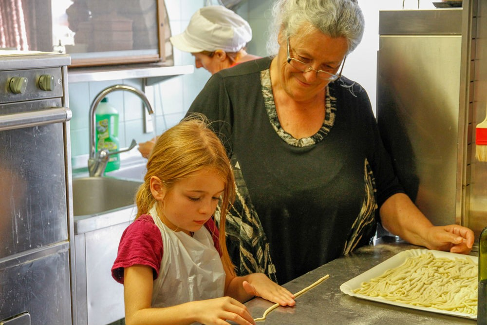 My daughter making pici pasta at Boscarecce Cooking School.