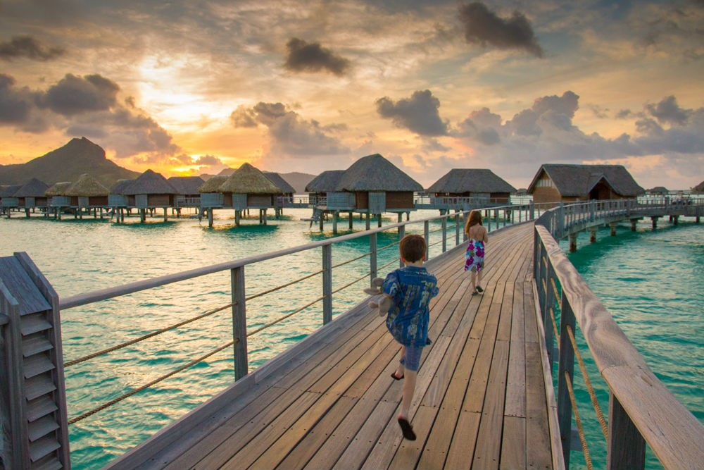 My kids running to dinner at the Four Seasons Bora Bora.