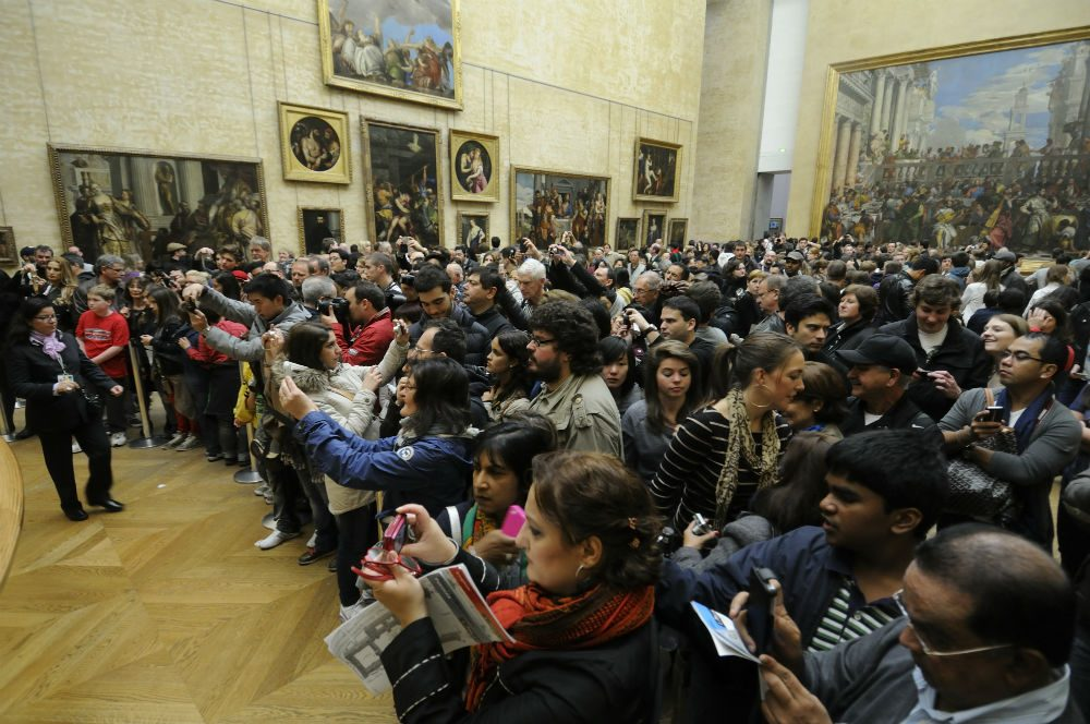 crowd in front of the Mona Lisa at the Louvre Paris France