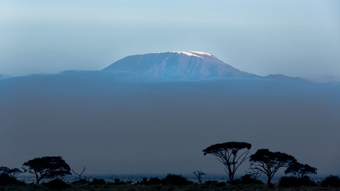 The summit of Kilimanjaro in Tanzania as seen from Amboseli, Kenya. Photo by Susan Portnoy