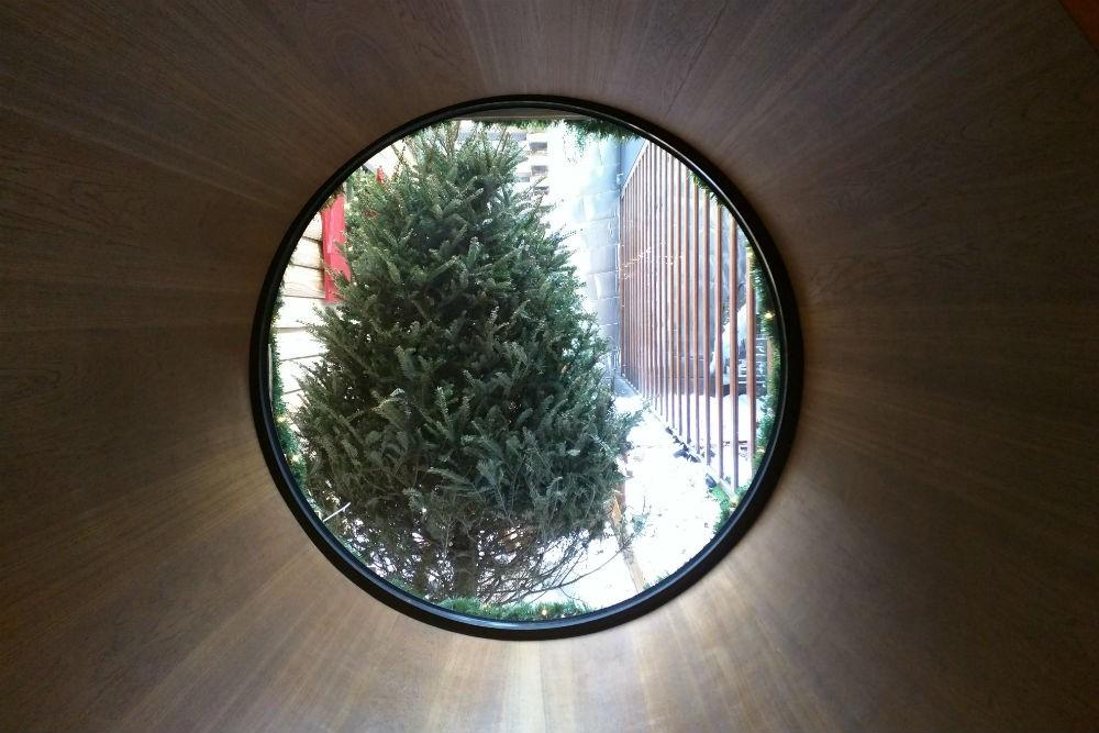 A view through a circular window onto the fake outdoor winter scene, Dream Downtown. Photo: Billie Cohen