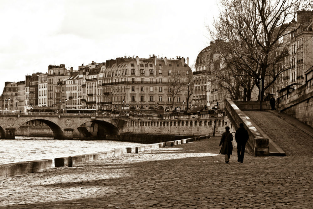 Romantic couple walkng through Paris France