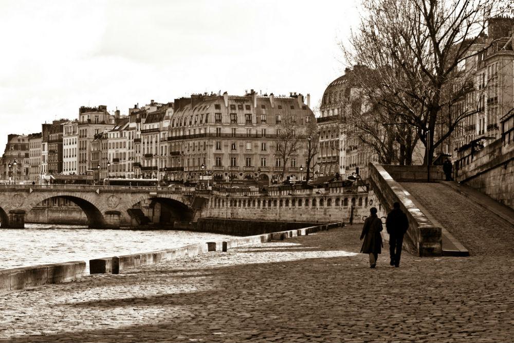 Romantic couple walkng through Paris France