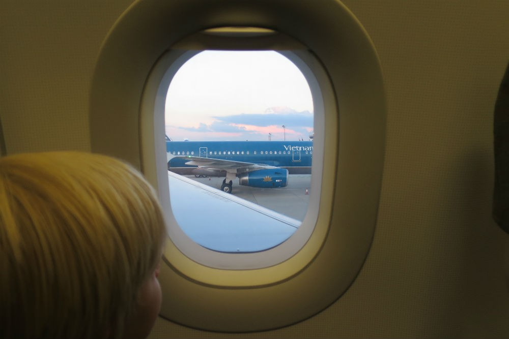 kid looking out airplane window