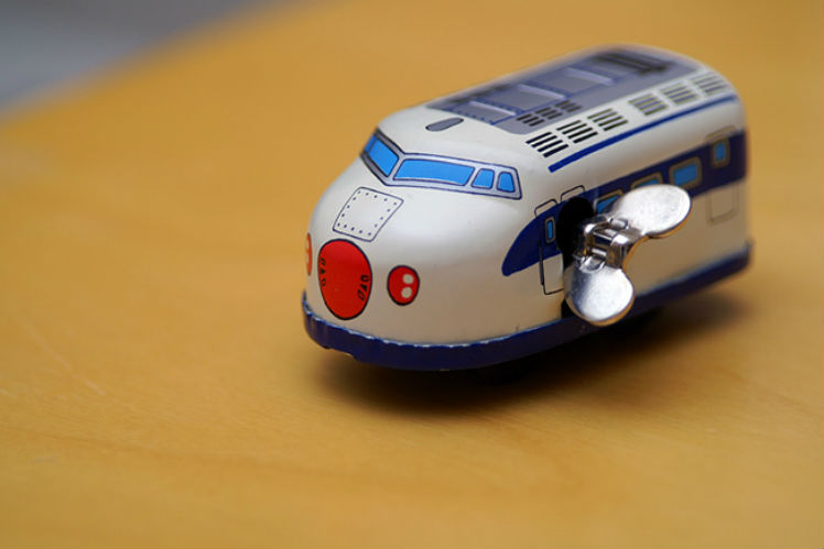 toy bullet train photo by Barron Fujimoto