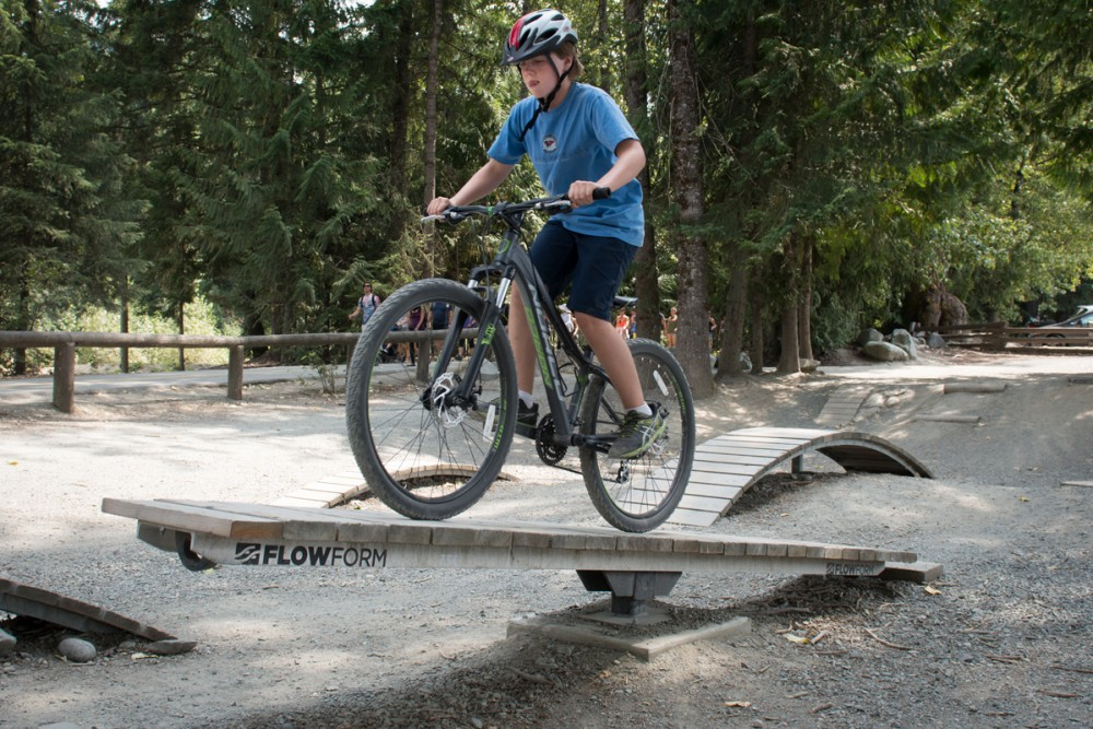 Doug tries his balance on a teeter-totter in Whistler's bike-skills park. Photo: Tim Baker.