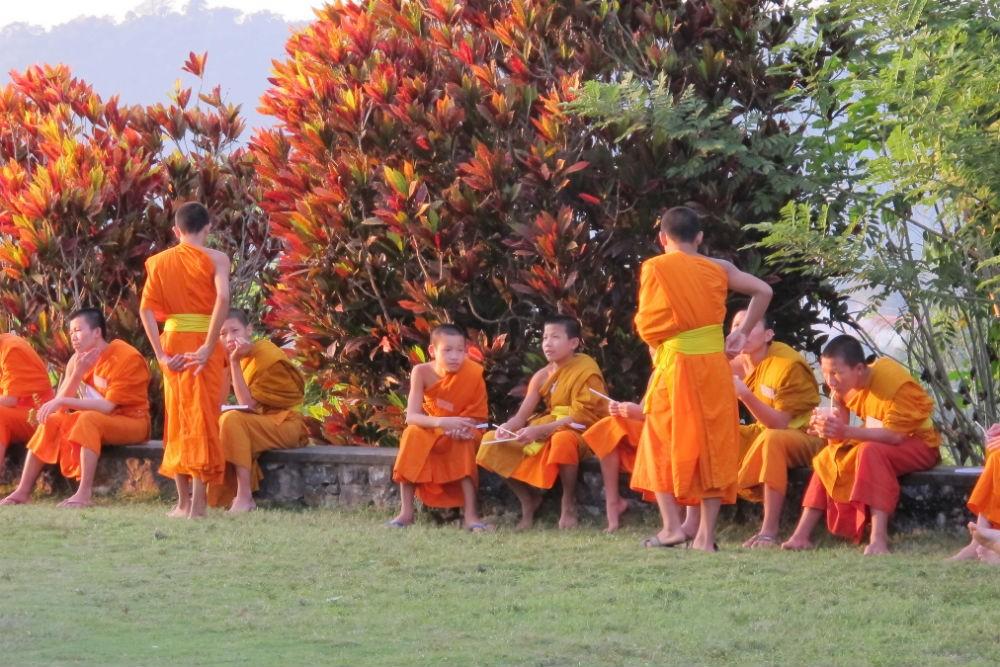 Monks in Luang Prabang, Laos photo credit Flickr/jayarc