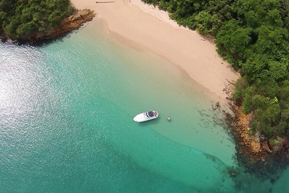 aerial photo of beach and boat on Pearl Islands, Panama