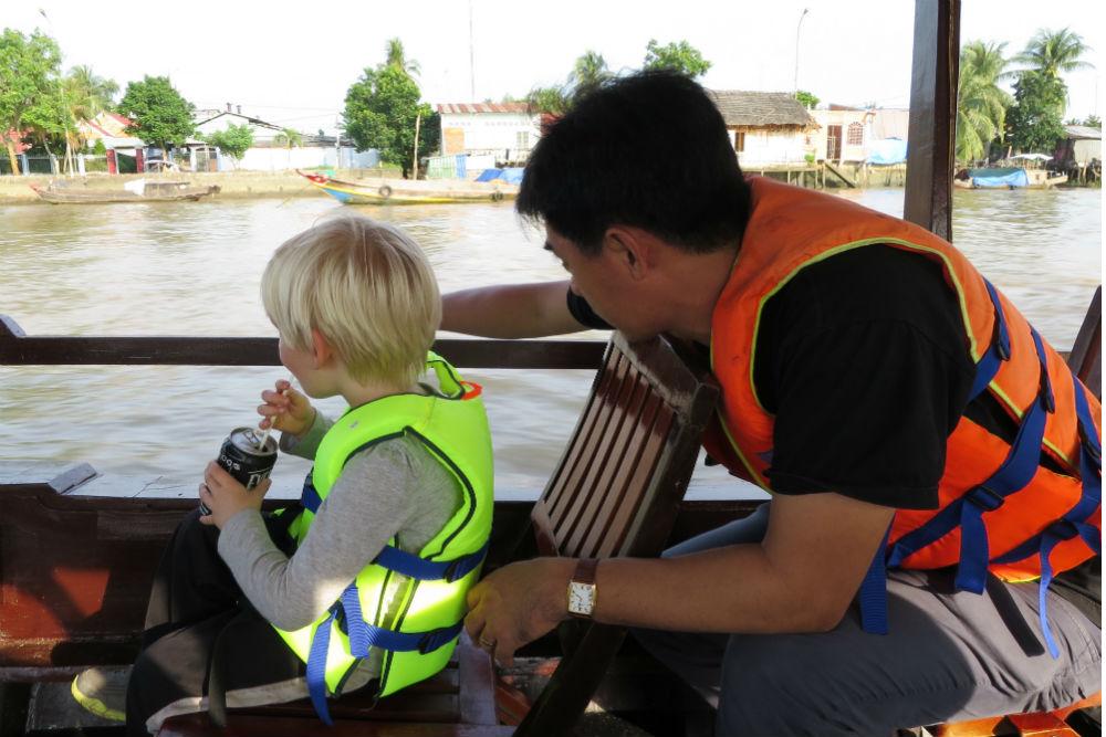 Enjoying a guided boat tour in Mekong River