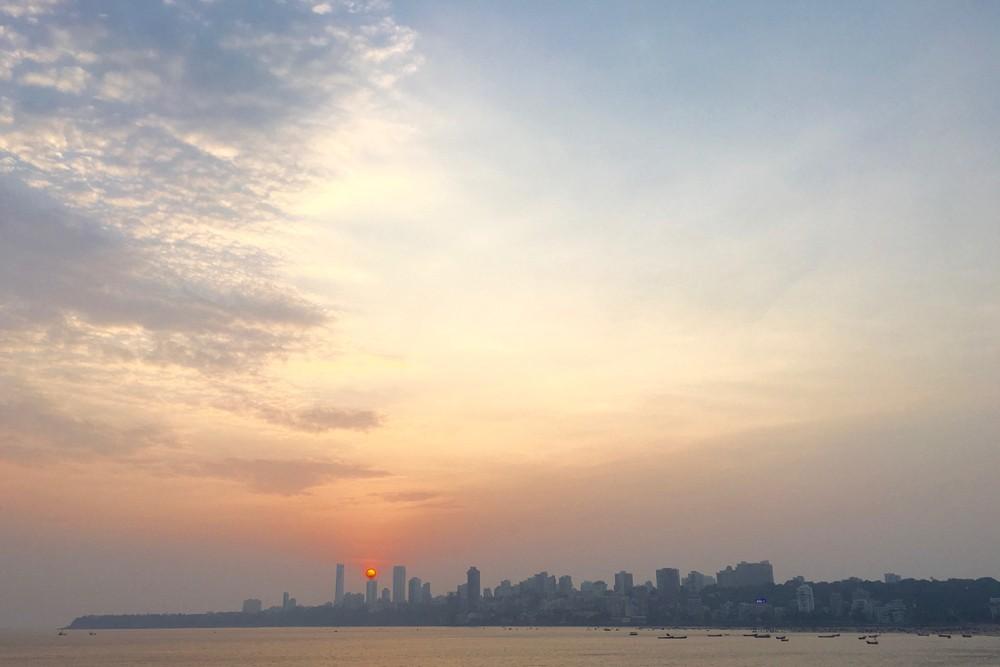 Sunset over the city taken from Marine Drive, Mumbai India. Photo India Beat