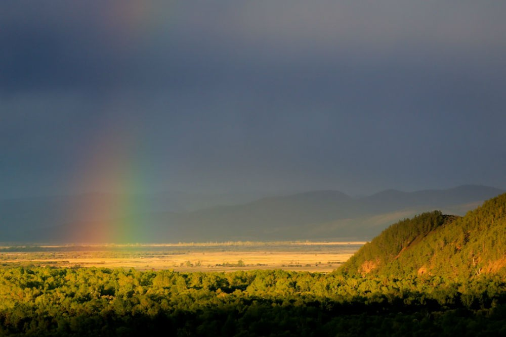 Mongolia's landscape with a rainbow. Photo: Nomadic Expeditions