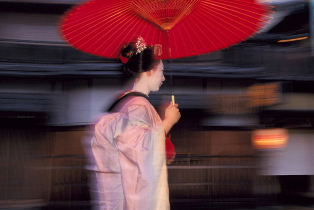 geisha with umbrella in kyoto japan