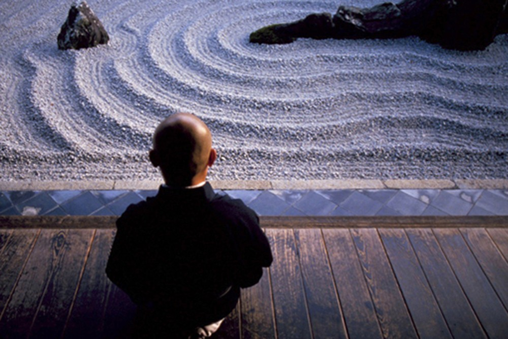 A Buddhist monk contemplates the zen garden at Zuiho-In Temple in Kyoto, Japan. Photo: Ben Simmons