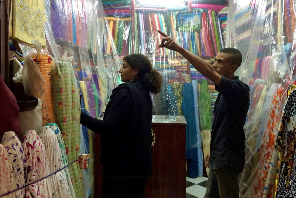 Nawal inspects fabrics for my new jacket.
