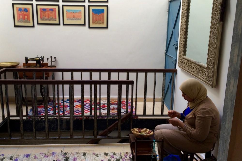 A seamstress in Nawal's studio.
