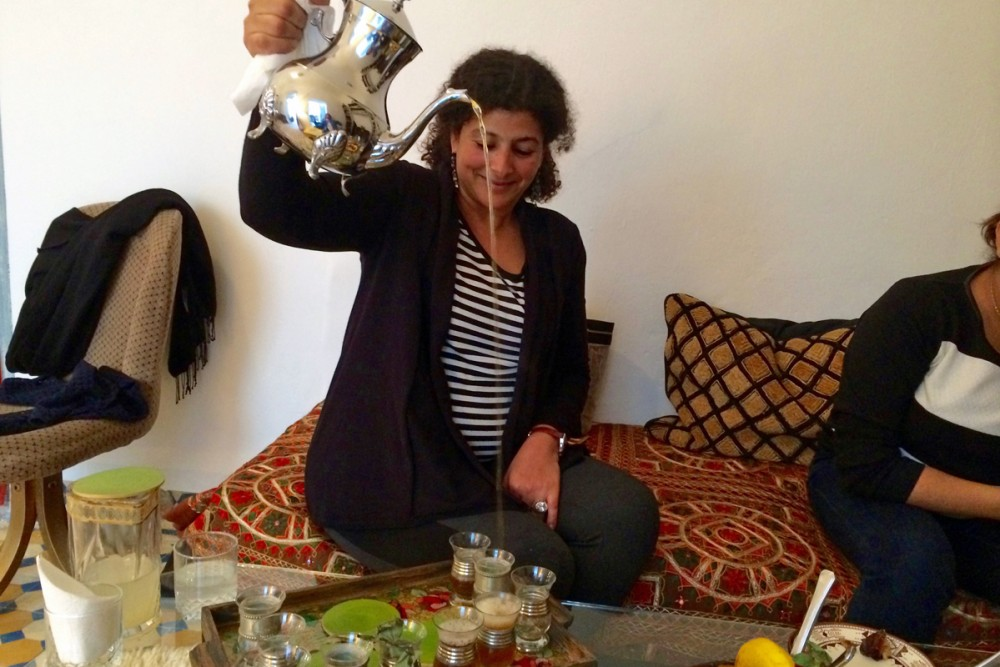 Aya pouring tea the Moroccan way.