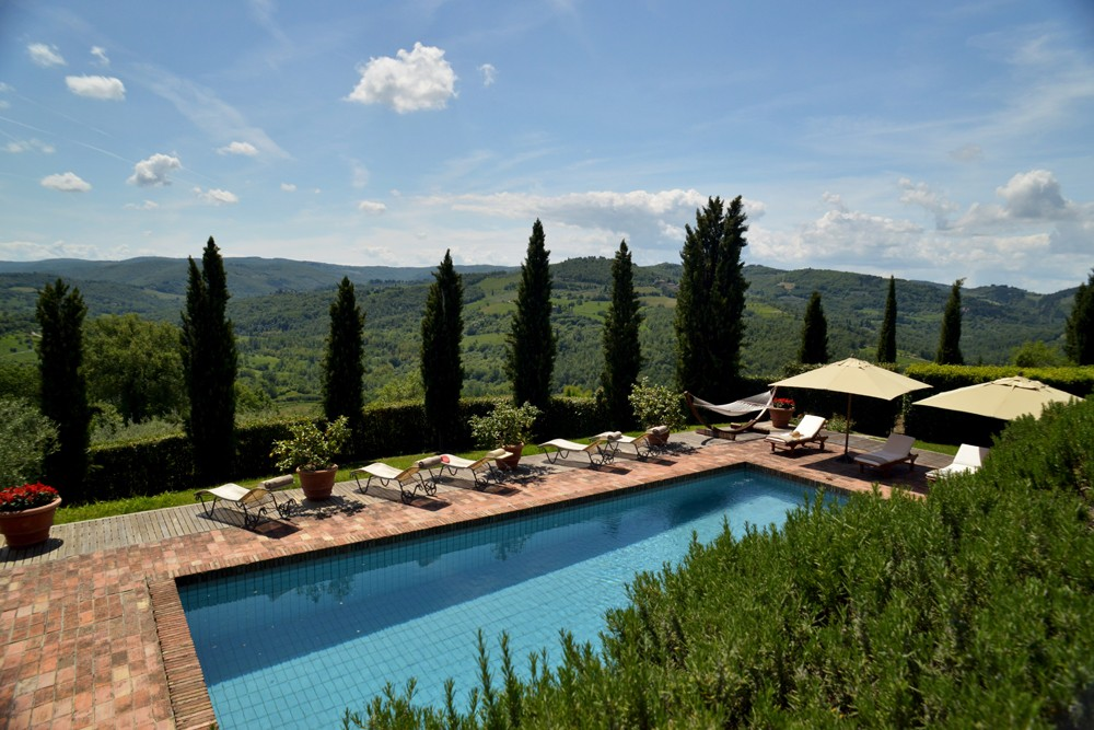 Poolside and deck view. Ca di Pesa Italy villa