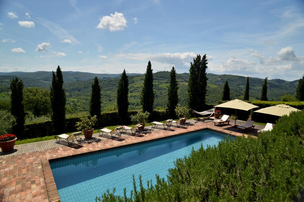 Poolside and deck view. Ca di Pesa Italy villa