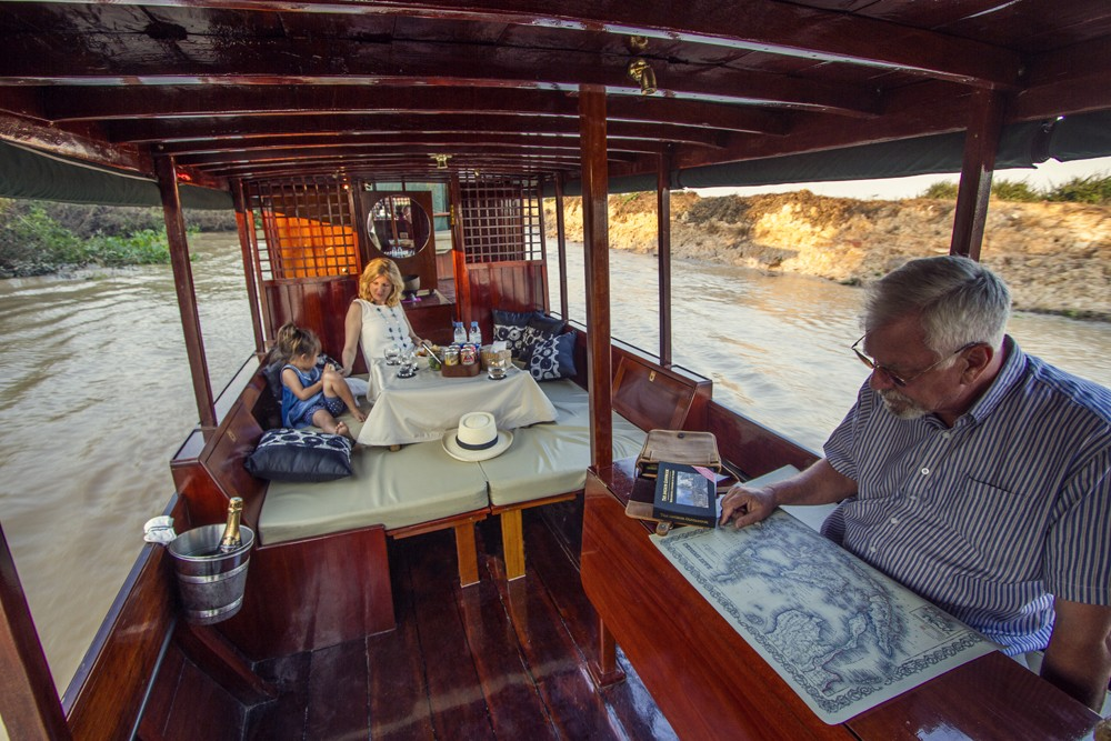 The Ella, ABOUTAsia's custom-made wooden boat, which is used for private cruises on Tonle Sap