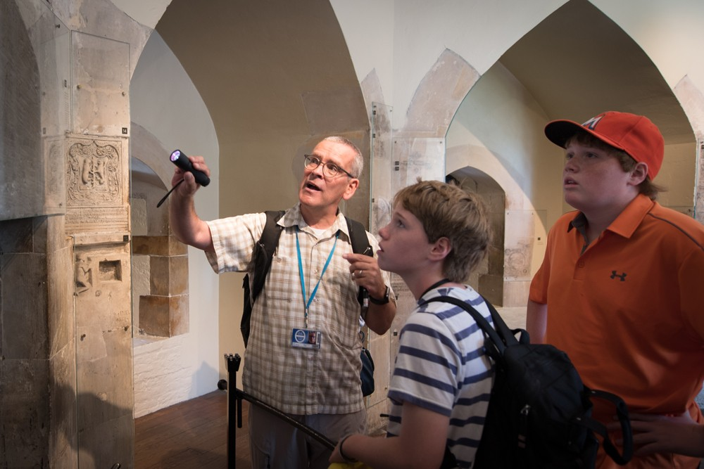 "In the Tower of London our guide, Sean Moran, showed us ""graffiti"" carved by prisoners centuries ago."