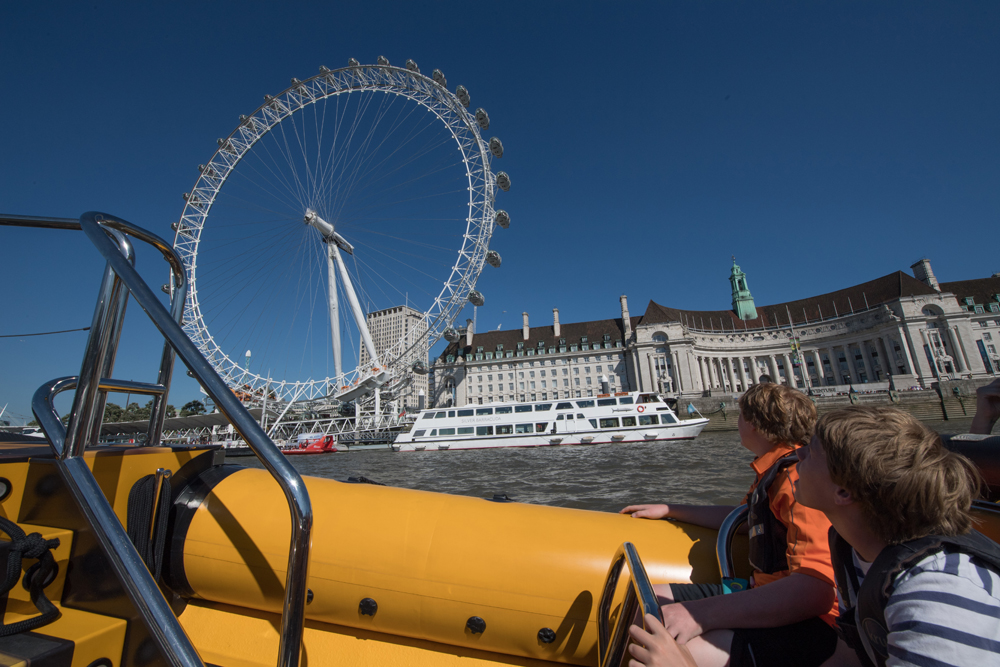 A rib ride on the Thames River is a fun way to see waterfront sights such as the London Eye.