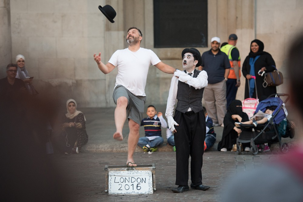 A Charlie Chaplin impersonator at Covent Garden.
