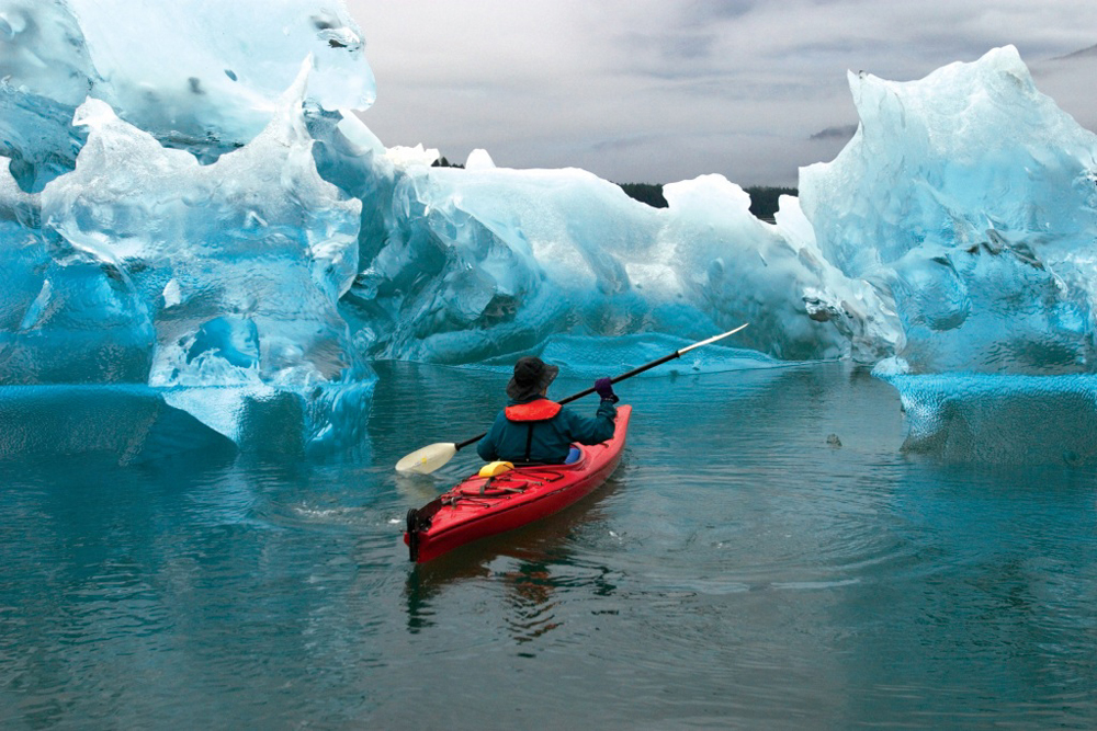 Kayak and sculpted iceburg, Tracy Arm Fjord: Tracy Arm-Fords Terror Wilderness, Tongass National Forest, Southeast Alaska