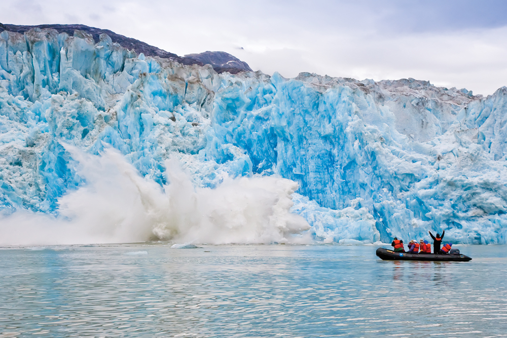 Guests explore on Zodiac in Southeast Alaska, Tracy Arm, calving ice