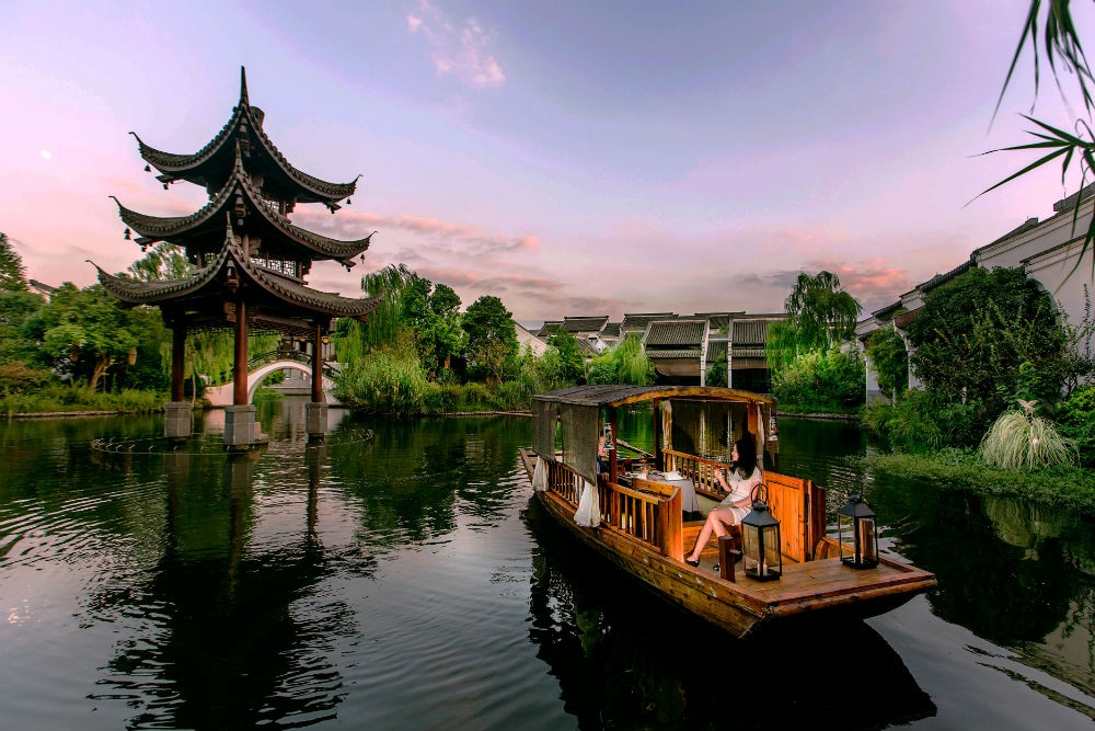 Hangzhou west lake with Banyan tree and boat
