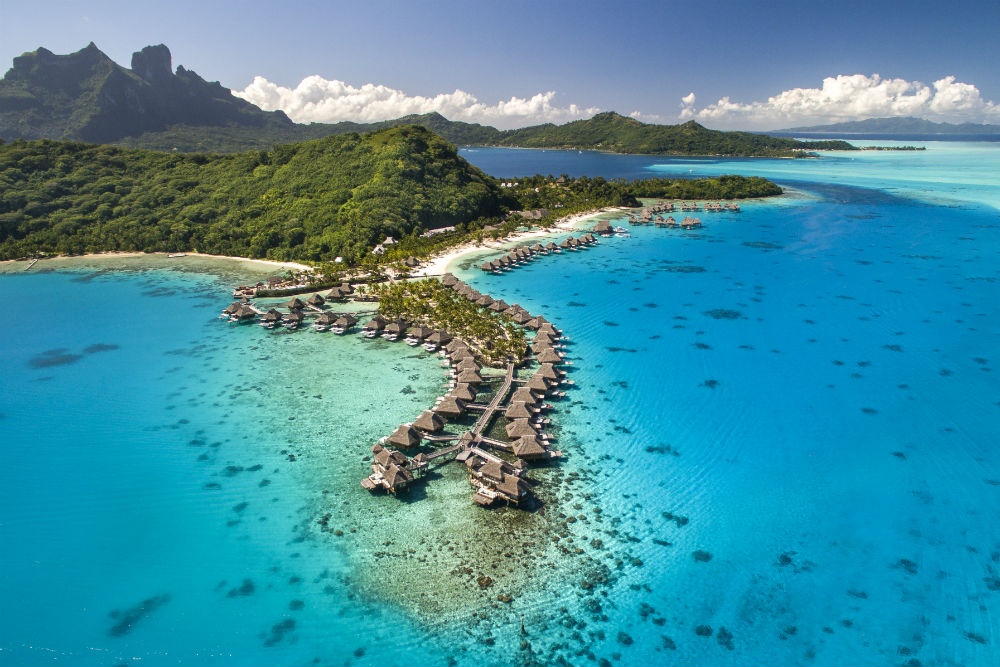 overwater bungalows in French Polynesia at the Conrad Hilton Bora Bora