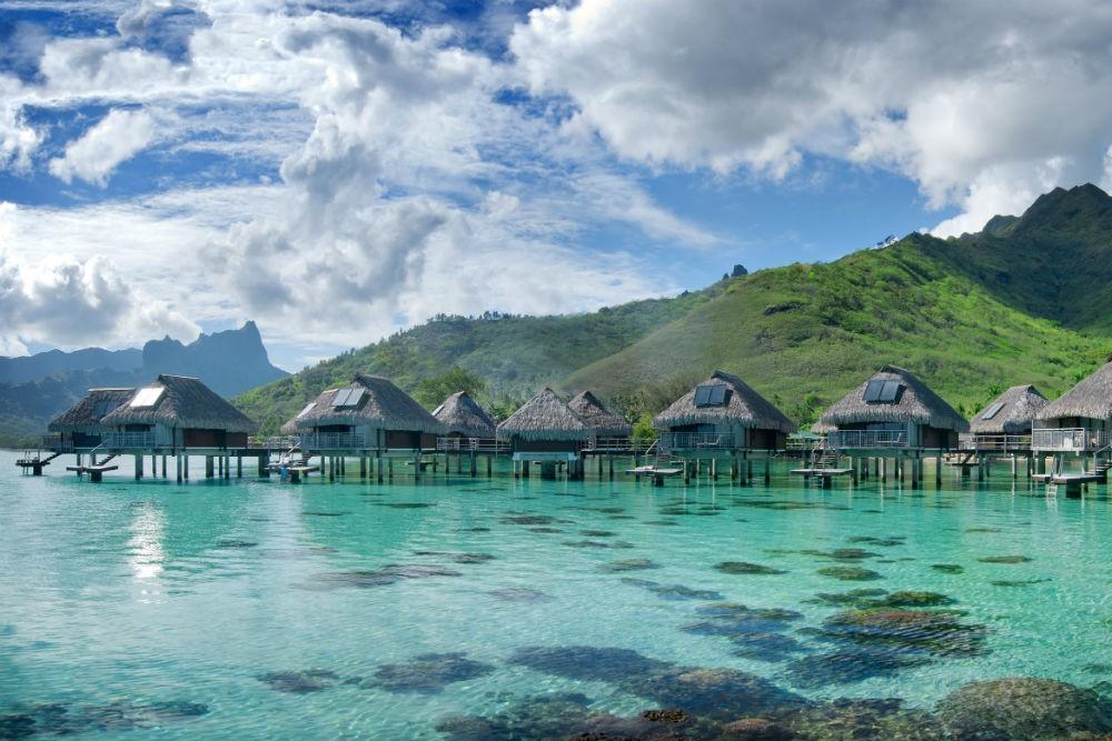 overwater bungalows in French Polynesia at the Conrad Hilton Bora Bora