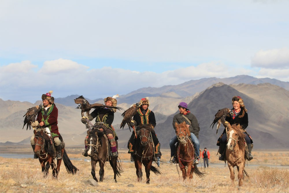mongolian eagle hunters at the golden eagle festival