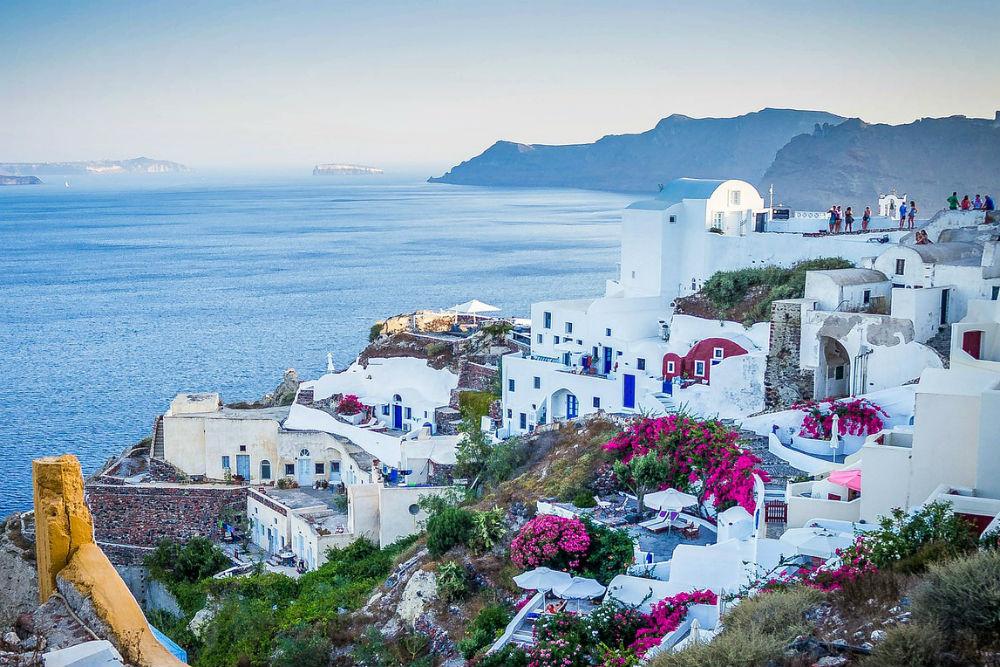white buildings of oia santorini overlooking the ocean greece