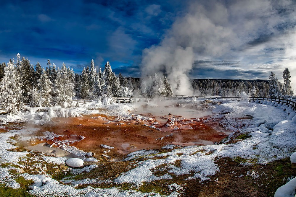 snowy scene of hot spring steaming in winter in Yellowstone National Park