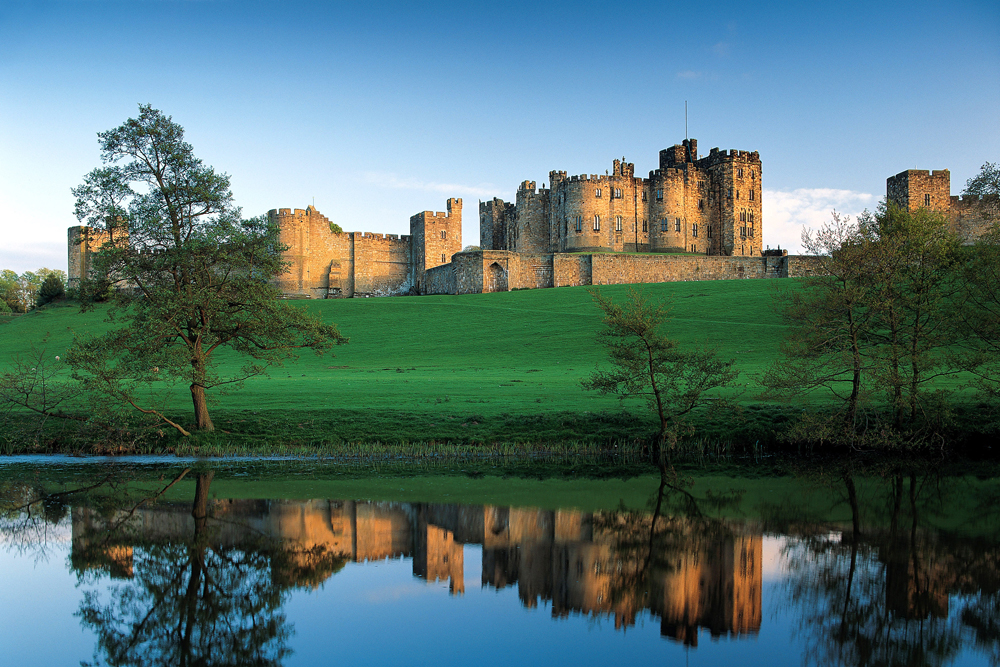 Alnwick Castle reflected in the river.