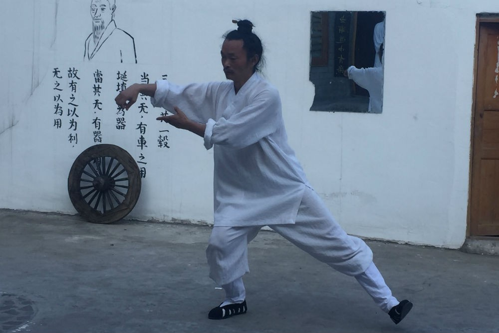 A Taoist priest performs tai chi in China's Wudang mountain range, the birthplace of the martial ar